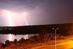 Powerful lightning strikes the ground Stock Photos