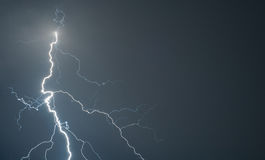Powerful lightning strikes the ground during storm Stock Photo