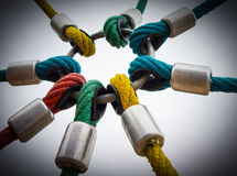 Powerful links. Concept image of powerful links, colored ropes linked to a common loop