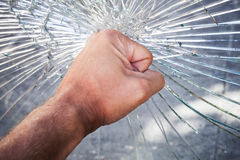 Powerful male fist with broken glass. Powerful male fist with broken window glass Stock Image