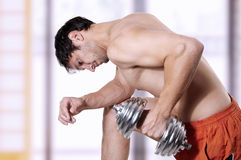 Powerful man lifting weights Royalty Free Stock Images