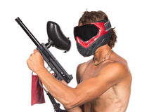Powerful man in red paintball mask with marker isolated. On white background Stock Photo