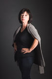Powerful, Mature Dark-Haired Woman Standing with Hands on Hips Stock Photos