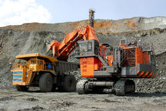 Powerful mechanisms. A picture is done in a career on the booty of iron-stone.The elements of side of quarry, and also equipment that is produce a booty and Royalty Free Stock Photos