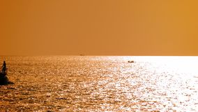Powerful modern motor yacht departs at sea at sunset Royalty Free Stock Photo