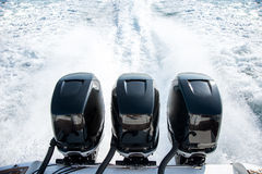Powerful motor for sports boat. Tree powerful motors for sports boat Royalty Free Stock Image