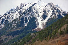 Powerful mountain partially covered with snow Royalty Free Stock Images