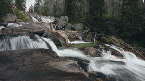 Mountain river with cascade waterfall in forest stock footage