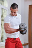 Powerful muscular man. Lifting weights Stock Photography