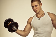 Powerful muscular man. Lifting weights - colorized photo Stock Photo