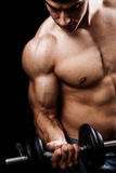 Powerful muscular man lifting weights stock photo