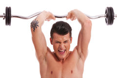 Powerful muscular man lifting weights Royalty Free Stock Photo