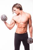 Powerful muscular man lifting weights. Against white background Royalty Free Stock Image