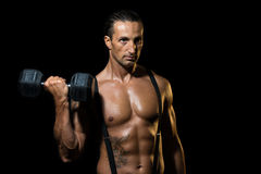Powerful muscular man lifting weights. Fitness - powerful muscular man lifting weights Royalty Free Stock Images