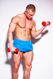 Powerful muscular man lifting weights. Powerful muscular man lifting weights,  on white Royalty Free Stock Photography