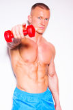 Powerful muscular man lifting weights. Royalty Free Stock Photography