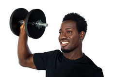 Powerful muscular young man lifting weights Royalty Free Stock Image