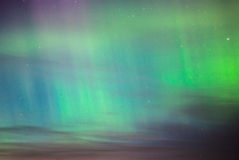 Colorful Norther Lights in the Night Sky. Powerful northern lights over night sky in Saaremaa Estonia. Aurora borealis was bright and with many colors. Red Stock Image