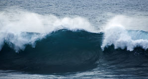 Powerful ocean wave breaking Stock Photos