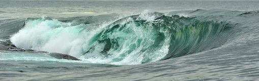Powerful ocean wave breaking. Wave on the surface of the ocean. Wave breaks on a shallow bank. Stock Photo
