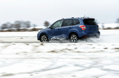 Powerful offroader car sliding by lake ice Stock Photos