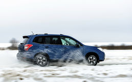 Powerful offroader car sliding by lake ice Royalty Free Stock Image