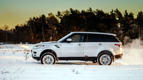 Powerful offroader car view on winter background Stock Images