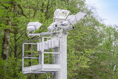 Powerful outdoor lighting lamps on the column on the ski slope in the spring close-up Stock Photo