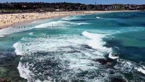 Pacific ocean waves at Bondi Beach, Sydney, Australia. Powerful Pacific Ocean waves flowing onto the yellow sand at Bondi Beach, Sydney, Australia. Summer sun stock video