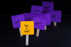 Powerful positive concept. Empowering concept image with yes I can written on a sticky note with other negative thought fading out of focus Royalty Free Stock Photo