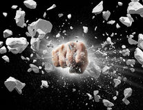Powerful punch. Powerful fist punches until broken into debris royalty free stock image