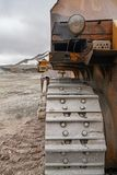 Powerful quarry bulldozer and gigat dump truck operating in the apatite mine in the Murmansk region royalty free stock images