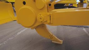 Powerful ripper. Attachments for bulldozer. Ripping equipment for construction machinery stock footage