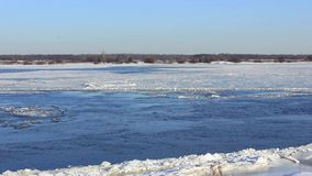 Powerful river does not freeze in winter. Ice drifts downstream stock footage