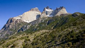 Powerful rocky peaks of Torres del Pain Stock Photos