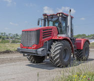Powerful Russian Agricultural tractor in red Royalty Free Stock Image