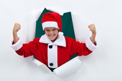 Powerful santa flexing his muscles Stock Images