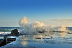 Powerful sea wave breaks on the shore Stock Photos