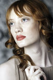 Powerful shot of a red-headed woman Royalty Free Stock Photo