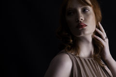 Powerful shot of a red-headed woman Royalty Free Stock Image