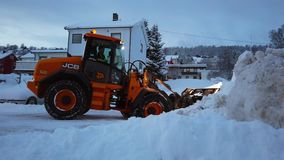 Powerful snowplough clearing parking lot. In Tromso town in winter, Norway stock video footage