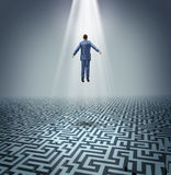 Powerful Solutions. With a businessman levitating above a maze or labyrinth as a business concept of leadership and conquering challenges and obstacles with a Royalty Free Stock Photography