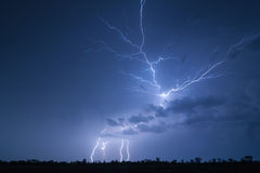 Powerful spider lightning. Impressive and complex spider lightning along with three lightning strikes Royalty Free Stock Photo