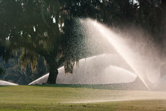 Powerful Spinklers Soak A Golf Course Fairway Royalty Free Stock Photography