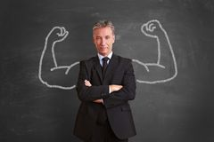 Successful businessman with chalk muscles stock photos