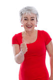 Powerful and successful older woman - thumbs up isolated. Stock Photos