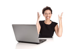 Powerful sucessful young business woman with computer in the off Royalty Free Stock Photography