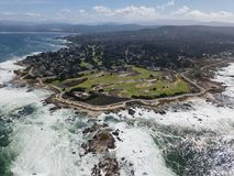 Aerial View of Pacific Ocean and Monterey Peninsula. Powerful swells from the Pacific Ocean wash against the rocky coastline of the Monterey peninsula in royalty free stock photography