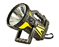 Powerful torch. In black and yellow plastic (rubberized) casing with built in handle and stand, glass window and large silvered reflector, white background royalty free stock photography