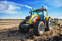 Powerful tractor working in a field Stock Photo